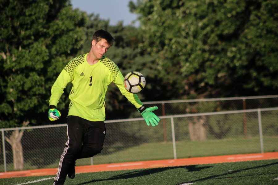 Braden Jergensen (12) kicks the ball out to his players. As the goalie, Jergensen is the team's last line of defence.
