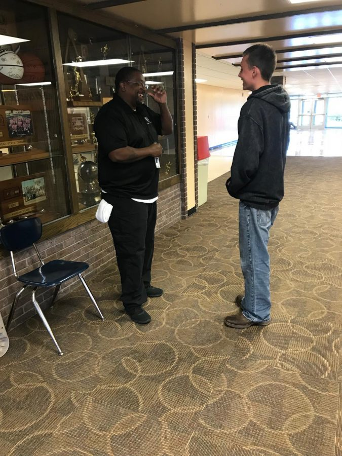 Marshal Potts (12) talks to security guard Nick Harris during lunch in the upper commons.  Harris sees part of his job as not only keeping the students safe but also supporting them.