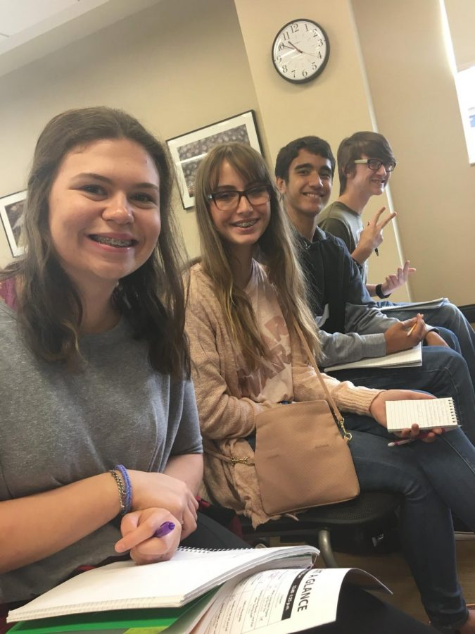 Staff members Lindsay Baugher (12), Maegan Morrison (10), Daniel Doll (10) and Jonathan Doss (10) wait for their Art of Interviewing session to begin. The staff learned how to get the most out of an interview.