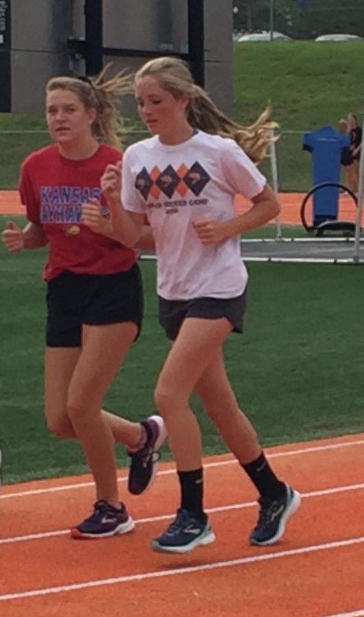 Keelynn Barnett (9) and Porsha Zweifel (9) take to the track for the teams' warm-up.