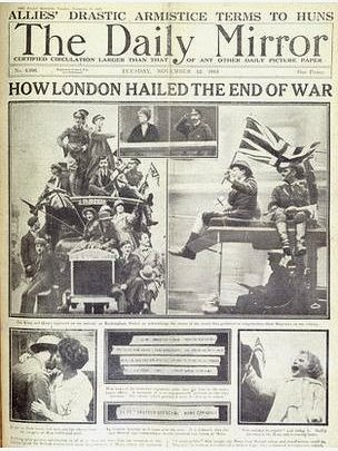 A newspaper clipping of the Daily Mirror showing images of people celebrating the end of World War I.