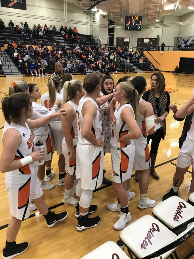 Basketball coach Rainey Maloy tells Jaydenlee Marlnee (12) to break the team down. The team then lost to Abilene in overtime.