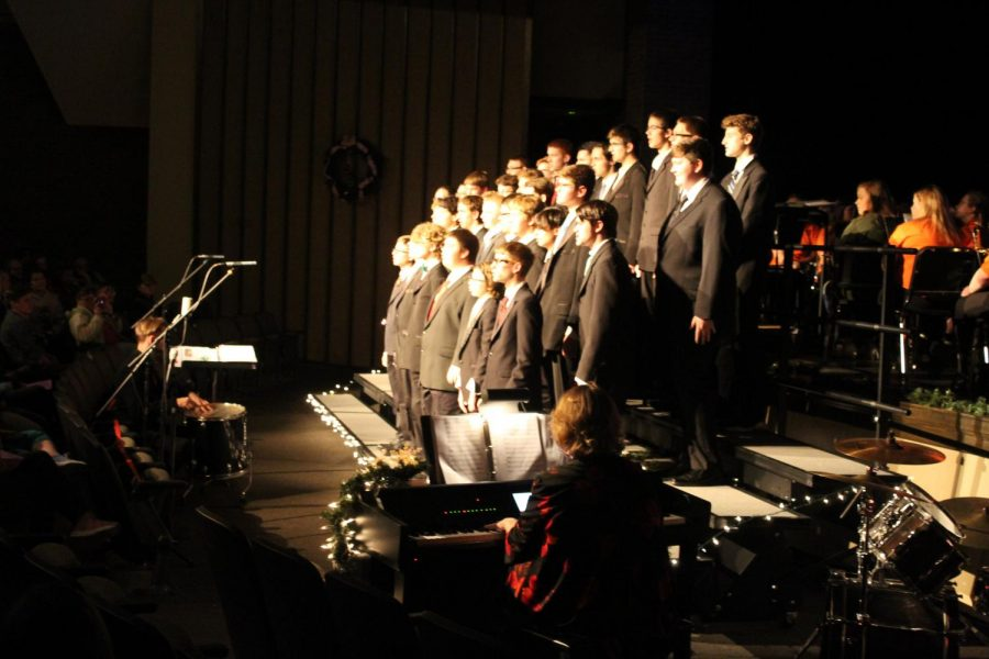 Men's choir presents their portion of the band and choir Winter Concert.
