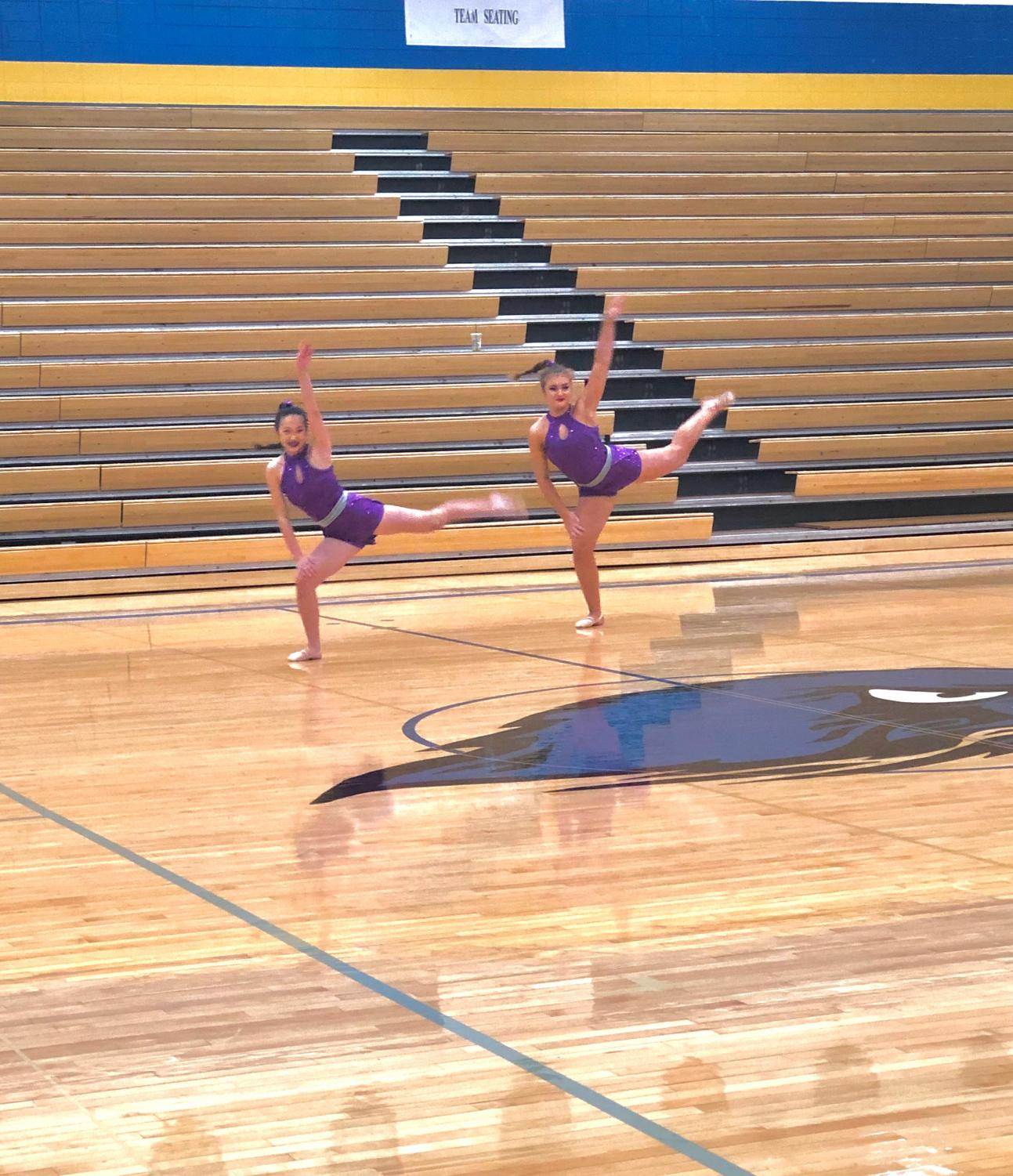 Kenzie Childers (11) and Maddie Ray (11) perform a duet at the State Dance Competition. The competition was pushed back two days due to inclement weather in the Kansas City area.