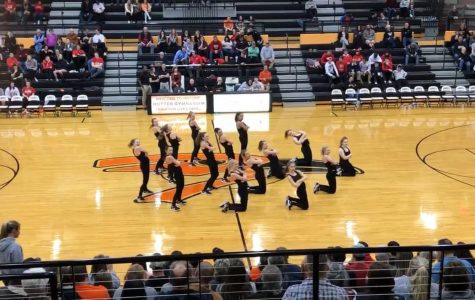 The Oriolettes perform during halftime of the boys varsity game Jan. 8. The Oriolettes will perform at state dance competition Jan. 18-19 in Olathe East High School.