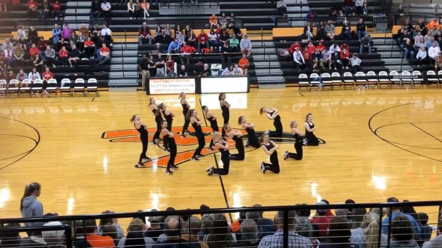 The+Oriolettes+perform+during+halftime+of+the+boys+varsity+game+Jan.+8.+The+Oriolettes+will+perform+at+state+dance+competition+Jan.+18-19+in+Olathe+East+High+School.
