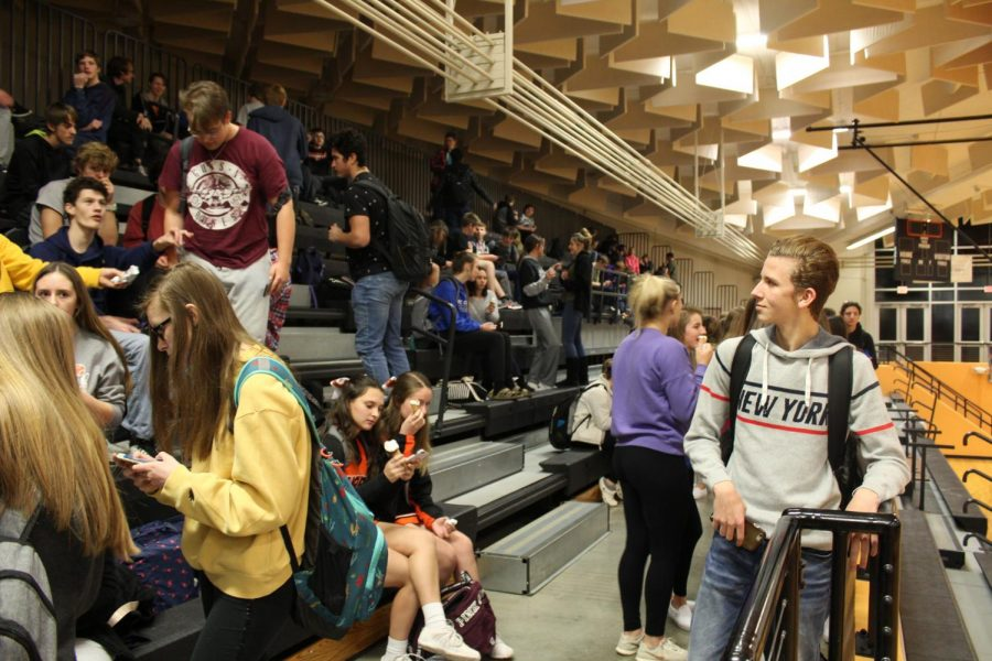 Students gather together in the gymnasium to celebrate not being tardy during the No Tardy Party Jan. 17. Students are rewarded with ice cream and time to converse with friends.