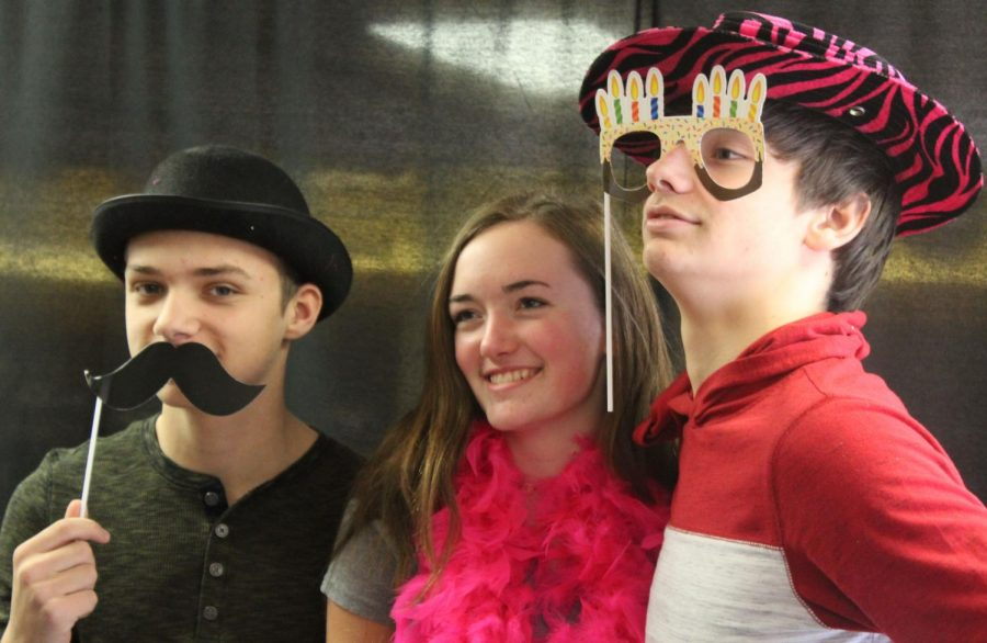 Grace Stueven (9), Payton Lewis (9), and Brendon Wedel (9) participate in the photo booth. The photos were part of The Great Kindness Challenge.