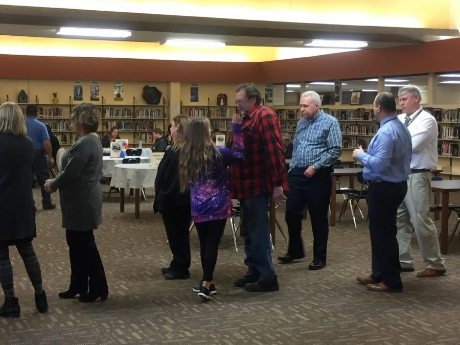 Student and their parents gather in the library to celebrate their achievement. Principal Donna Zerr choses the high school student of the month.