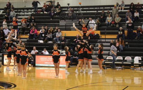 The Oriolettes join the combined basketball and wrestling cheer squads to entertain the crowd during halftime of the boys varsity game Feb. 8. The cheerleaders and dancers planned a special routine for the winter homecoming halftime performance.