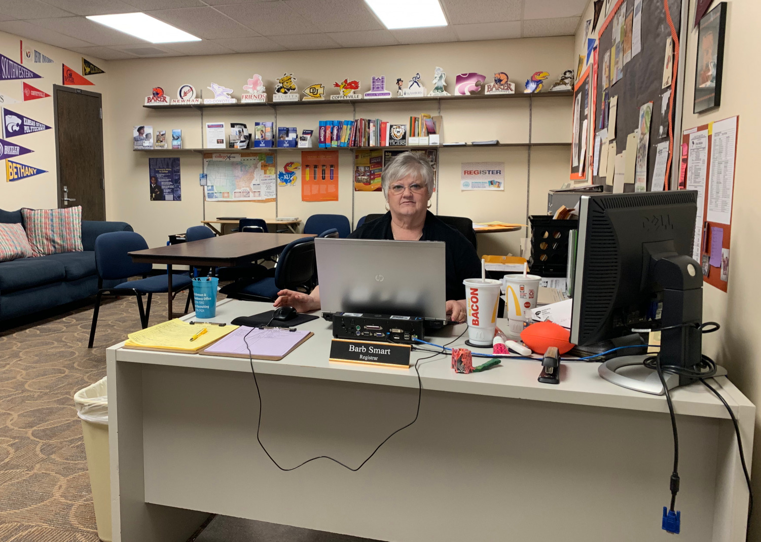 Registrar Barb Smart helps students arrange meetings with the counselors. They must sign up on the purple or yellow sheet depending on which counselor the student would like to meet. Photo by Paige Harrington