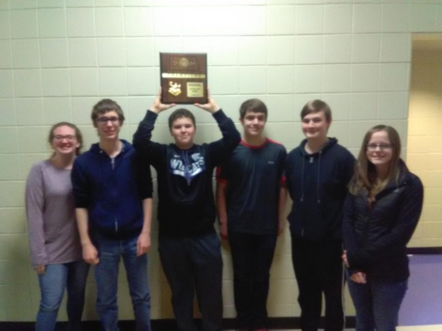 Members of the scholars bowl team hold their first place trophy from regional contest. The team placed 5th at the state competition.