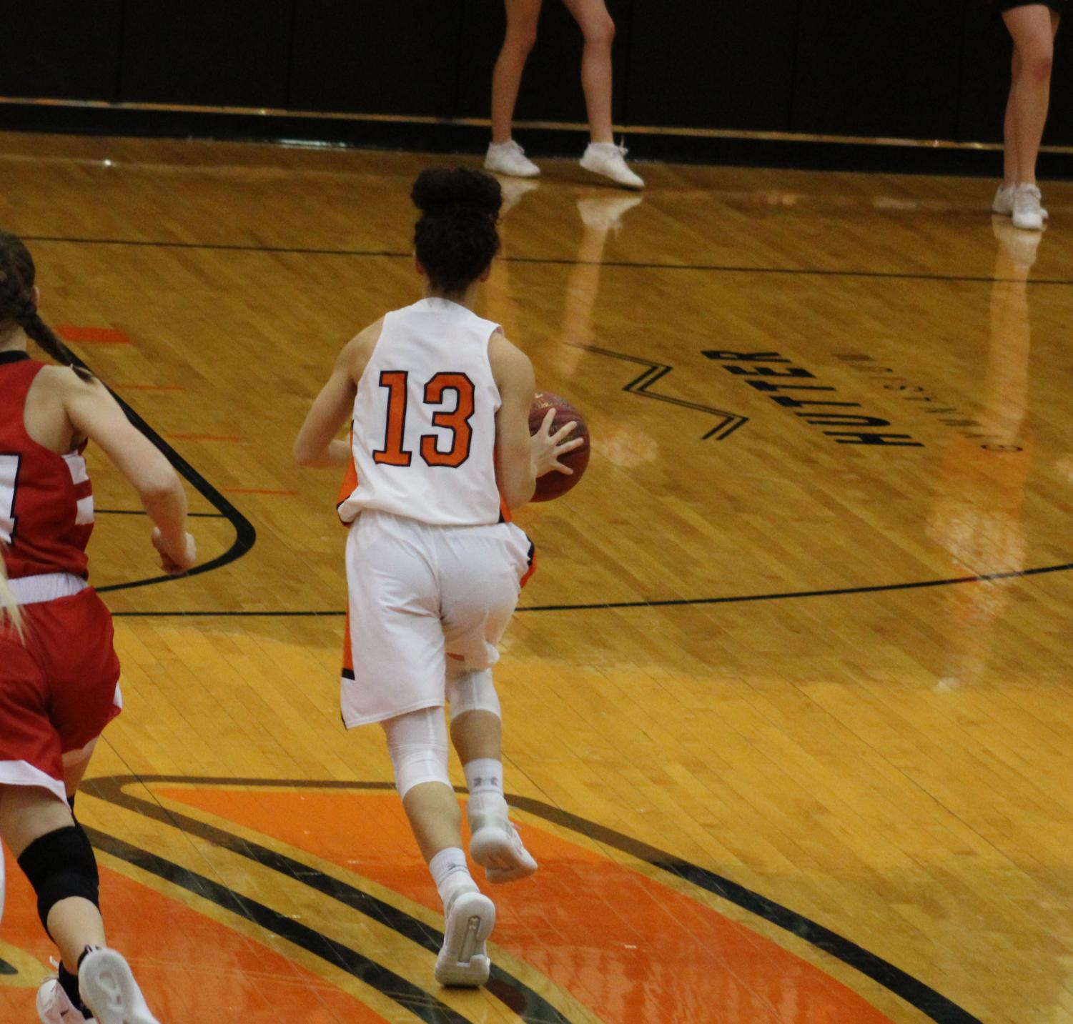 Maycee Anderson (10) takes the ball down the court. The Orioles defeated Rose Hill Feb. 1 at home.