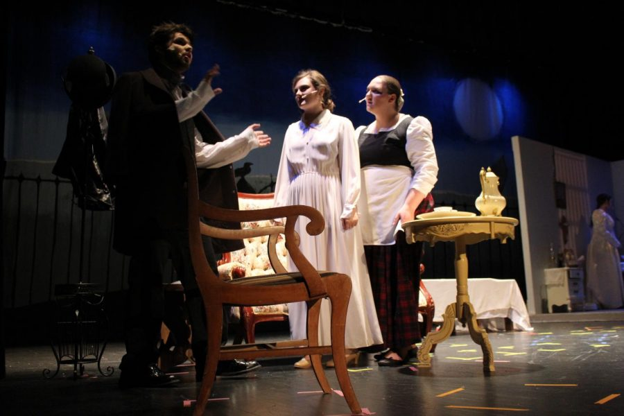 Virginia, played by Samantha Dudeck (11) and Maria, played by Makayla Hughes (12) are angry at Edgar Allen Poe, played by Noah Rye (10) for spending money drinking again.