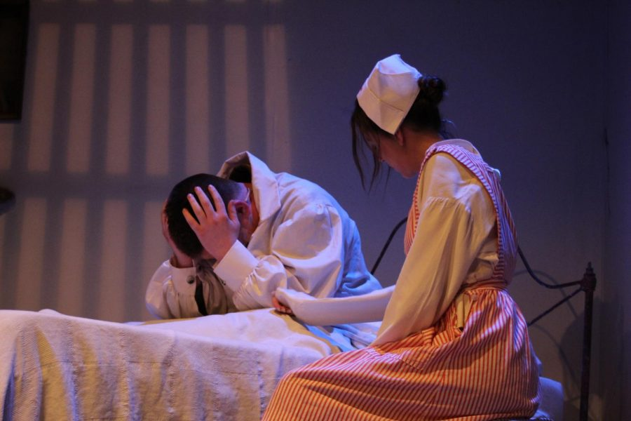 The nurse, played by Juliene Fuson (9) comforts older Edgar Allen Poe, played by Gabriel Wilson (9) as he thinks back on his life.