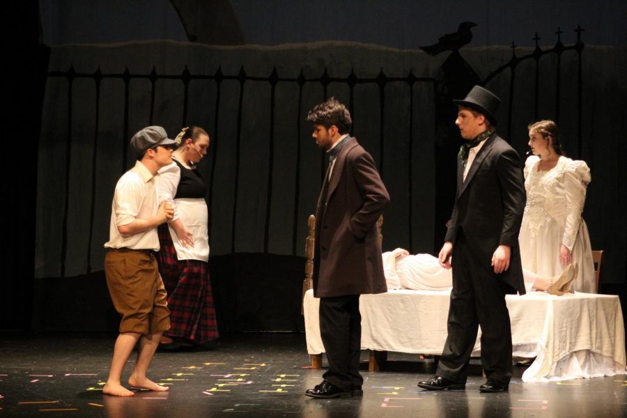 Skyler [last name] (12) plays a messenger telling Edgar Allen Poe, played by Noah Rye (10) about Virginia, played by Samantha Dudeck (11) and her illness, as Robert Merrill, played by Michael Carter (10) listens in.