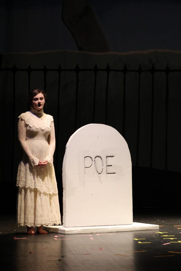 The ghost of Virginia, played by Samantha Dudeck (11) sings a lullaby as she stands next to her grave.
