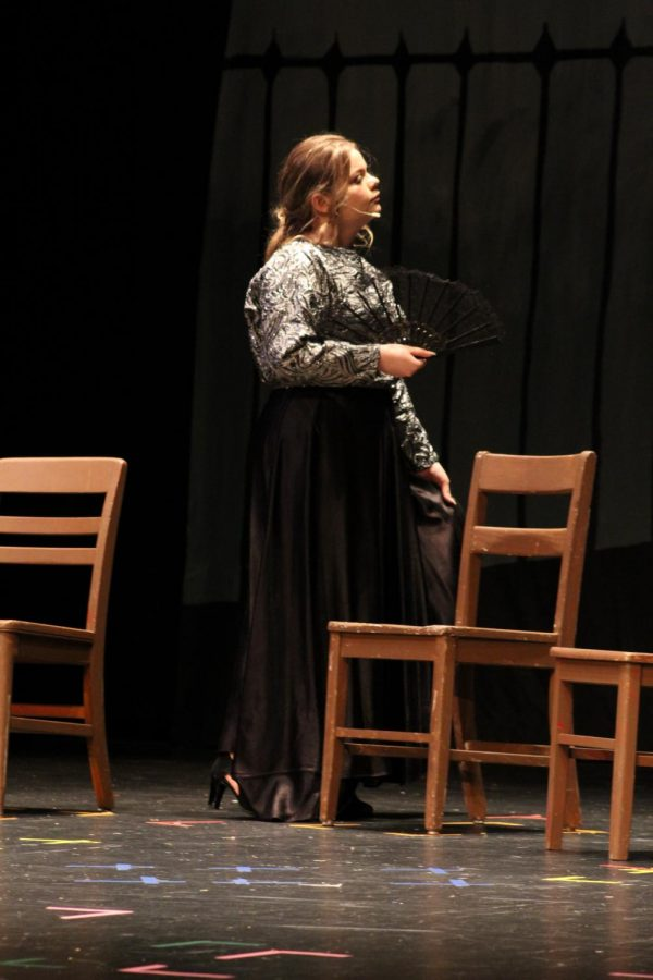 Autumn Ferguson (9) plays as multiple minor roles. Here, she plays as a fawning woman.