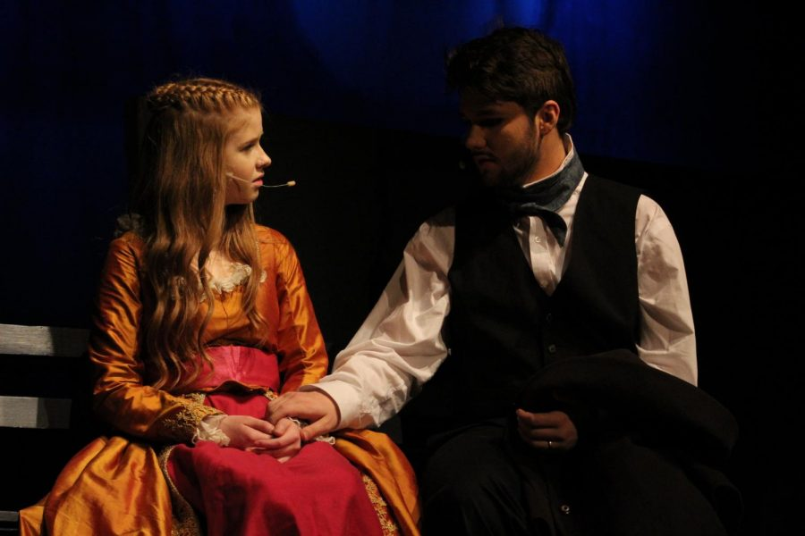 Edgar Allen Poe, played by Noah Rye (10) talks with Fanny Osgood, played by Ariana Ramseyer (9) after running away from a party.