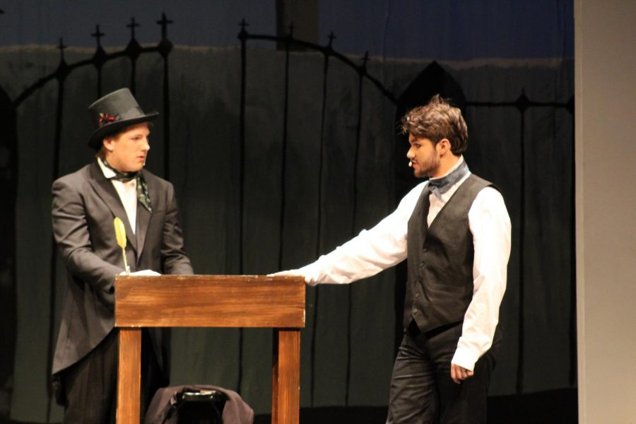 Edgar Allen Poe, played by Noah Rye (10) and Robert Merrill, played by Michael Carter (10) talk about the process of gaining subscriptions for Poes magazine.