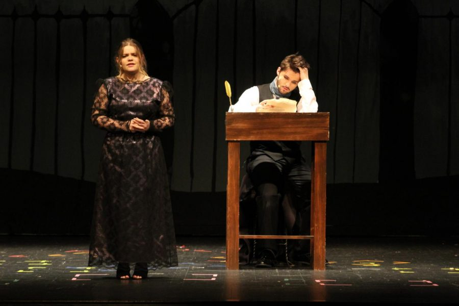 Edgar Allen Poe, played by Noah Rye (10) reads the replies of his love letter. One of the responses is from Elmira, played by Autumn Ferguson (9).