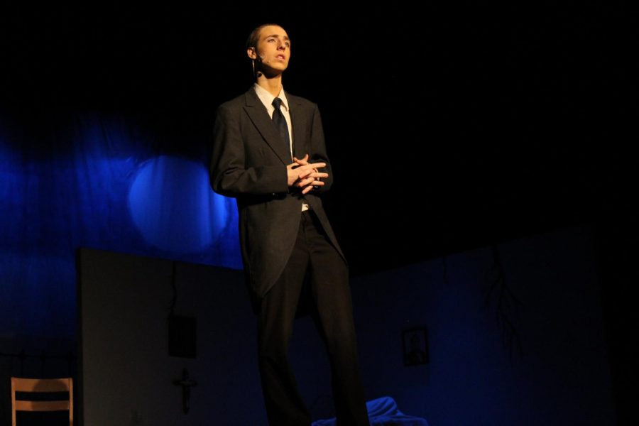 Owen Frizell (10) plays as the narrator in the Tell Tale Heart section of the Tell Tale play.