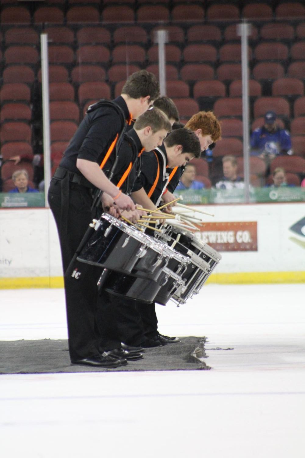 Drumline+performs+the+cadence+%E2%80%9CCheetah%22+at+the+Wichita+Thunder+hockey+game+April+3.+The+drumline+played+during+an+intermission+of+the+game.++