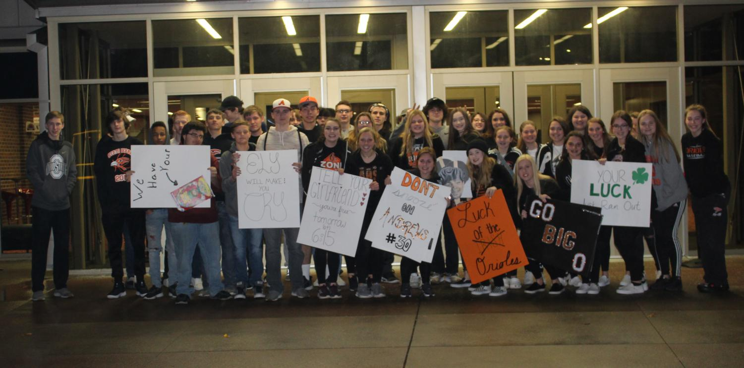After riding in two separate spirit buses, members of the O's Zone hold up their handmade posters. After winning against Chapman, they returned to Tony's Pizza Event Center the following Saturday to face Kansas City Piper.