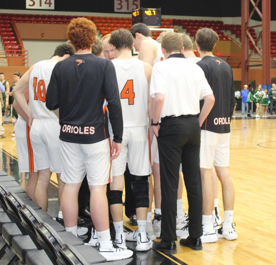 Both teams huddle up to talk game strategy with a little more than four minutes remaining on the clock. The ending score was 46-40.