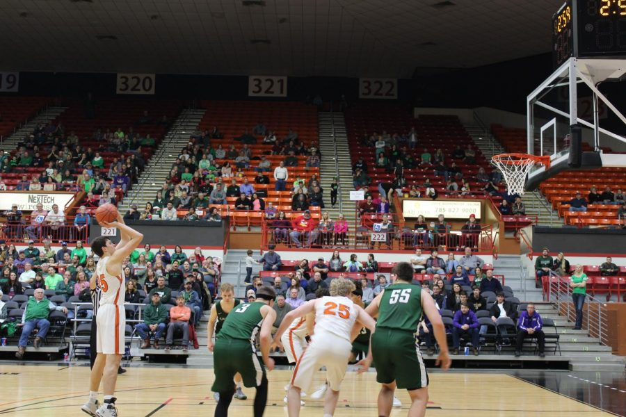Zach Davidson (11) shoots a free throw with three minutes left on the clock. Davidson was playing center during the game.