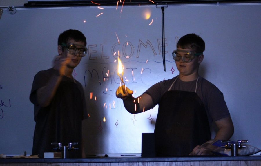 Advanced chemistry students Josh Woodsmall (11) and Calvin Spellman (11) join together to spark up the room with their experiment for elementary students. They had  worked on their experimentation all semester.