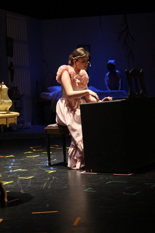 Virginia, played by Samantha Dudeck (11), sings a lullaby on the harpsichord.