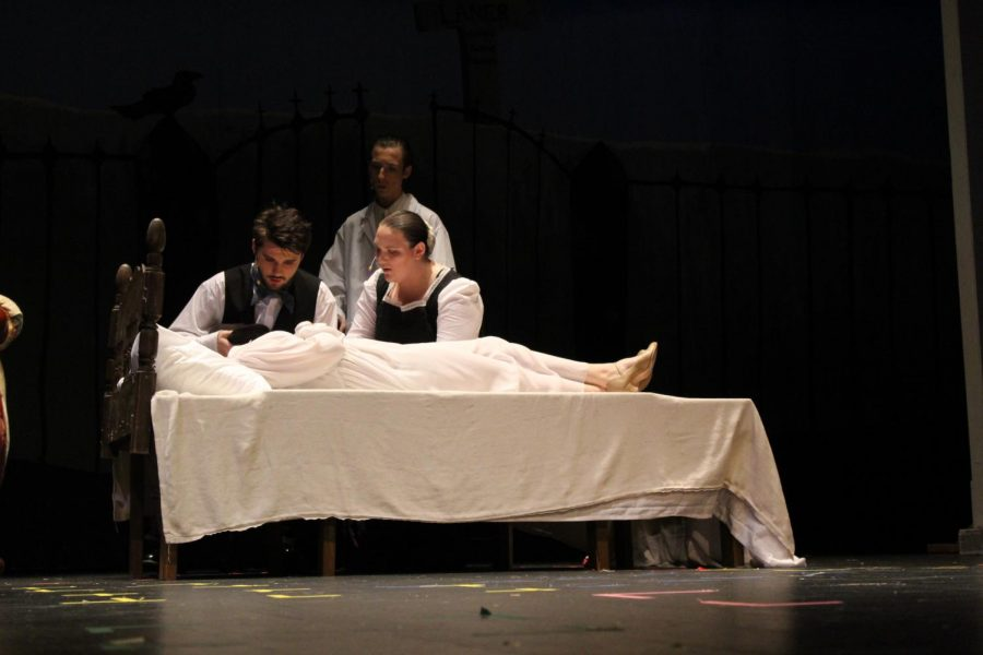During the play TellTale Michela Hughes (12), Noah Rye (10) and Owen Frizells (10) characters sing over the corpse of Sam Dudeks (11) character. The play was about the life of author Edgar Allen Poe.