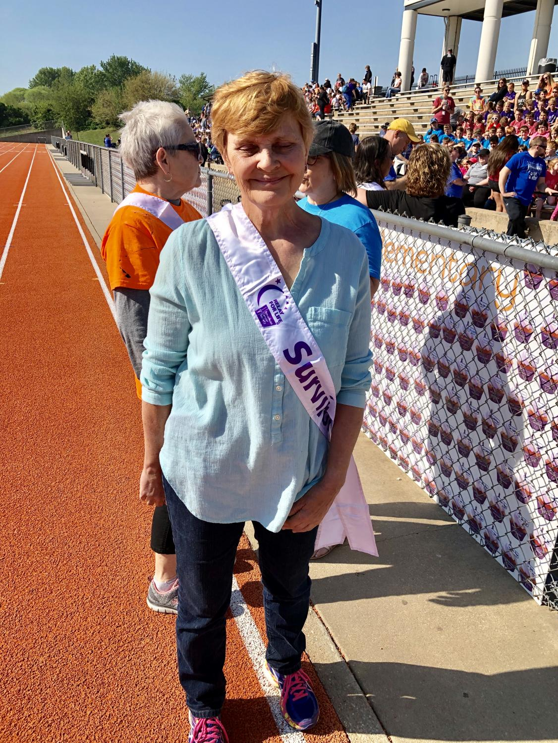 Former Robinson and Lincoln physical education teacher Tricia Lehr stands in the sun at the 2019 Relay Recess. Before Relay Recess started in Augusta, Lehr taught physical education at the time she was diagnosed with cancer. Teachers like Garfield Elementary teacher Diane Rhoten started Relay Recess to support Lehr and other cancer patients.