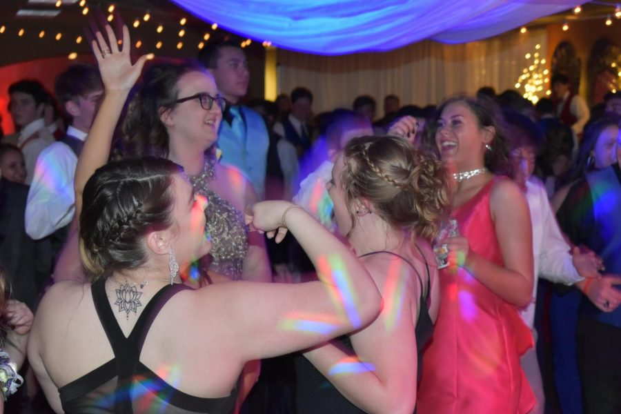 Jaci Bogner (12), Cassidy Dresher (12), Cortney Kellogg (12) and Augusta High alumna Madelyn Lynch boogie on the dance floor together. A hired DJ was in charge of the music being played, taking requests from anyone who asked.