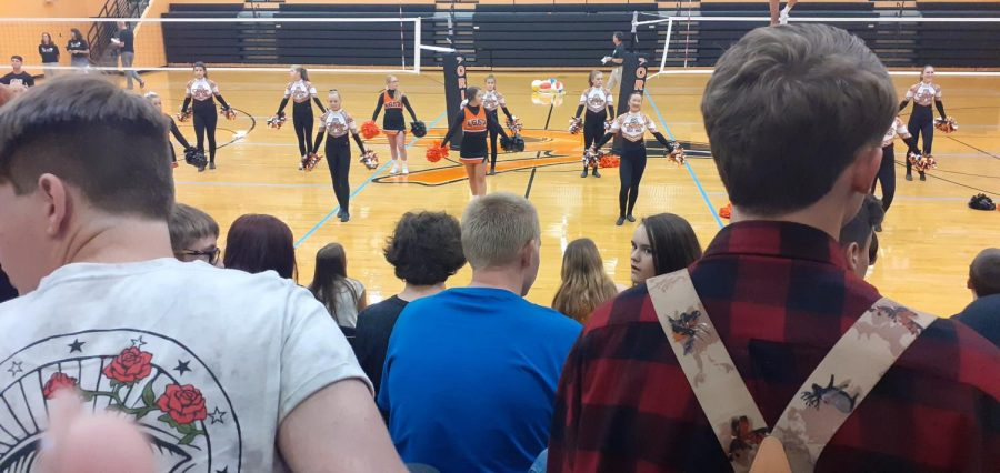 The+cheerleading+squad+and+the+dance+team+try+to+raise+the+students%27+excitement+for+the+upcoming+sports+season+during+the+first+day+pep+assembly+Aug.+15+in+Hutter+Gym.+All+students+contribute+to+the+image+of+the+school.+