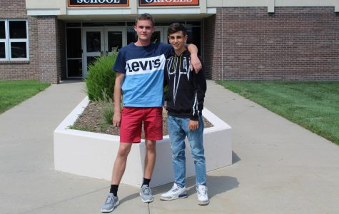 Junior Francesco Latte, from Italy, and senior Albert Kříž, from the Czech Republic, stand out side the high school. Both foreign exchange students are staying with the same host family, and they consider themselves brothers.