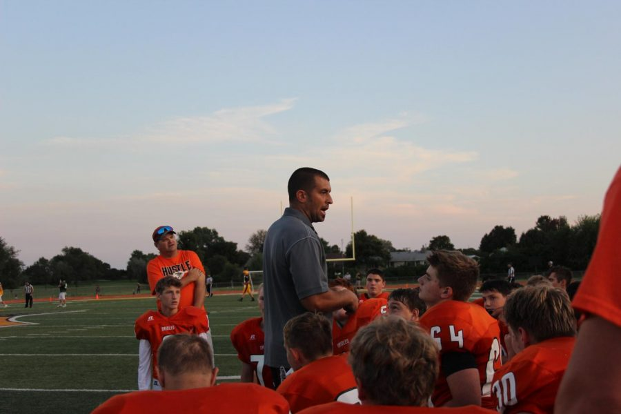 Football coach Jason Filbeck gives speech at the end of the jamboree. The jamboree was a pre-season game on Aug. 30.