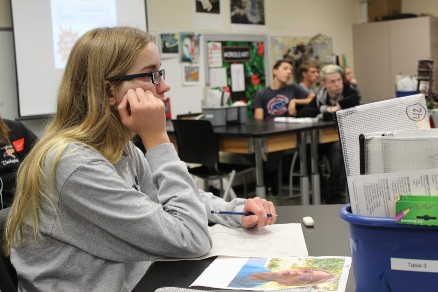 Sophomore Emily Webster, listening to instructions September 10. This photo was taken during Art club.