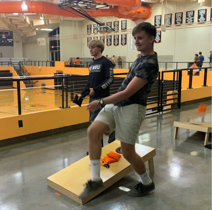 Senior Noah Coldwell September 12. He is competing in the AHS cornhole tournament.