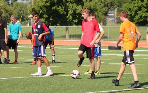 Athletes trying out for the soccer team prepare to run drills at the first practice.  The Orioles won their first game against El Dorado.