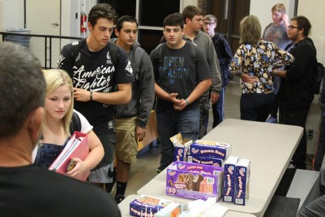 Sophomore Mercedes Bentley is walking through the line to pick out her ice cream followed by senior Austin Merz, senior Trenton Arredondo, and senior Raul Leedy at the No Tardy Party October 9th.