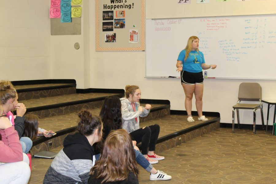 Senior Madison Griffith as she is explaining absences on the board to the rest of her choir class.