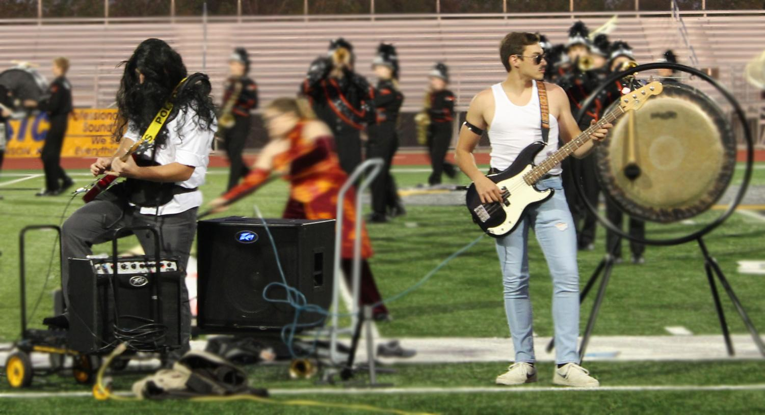 Senior Wyatt Timsah and Jacob Reavis jam out at Arkalalah dressed like Freddie Mercury and Brian May from Queen. The marching band received a 1 rating at contest.