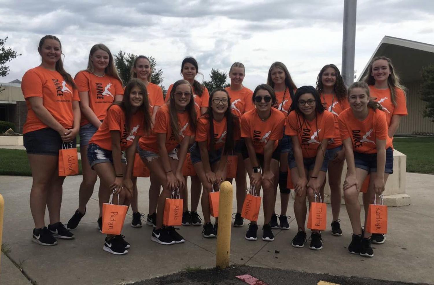 The Dance team poses in front of the high school before departing for their summer camp in Emporia. Senior Maddie Ray, junior Alexis Semisch, sophomore Trinity Tisdale, freshmen Lana Wood, and Aaralynn Chavana were nominated for the All-American dance team