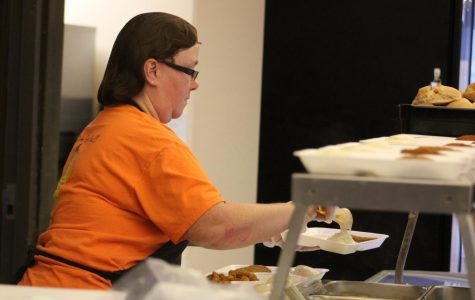 Lunch lady Tammy Stevens serves students at third lunch on Chicken Patty Wednesday. The majority of students would rather have first or second lunch to any other.