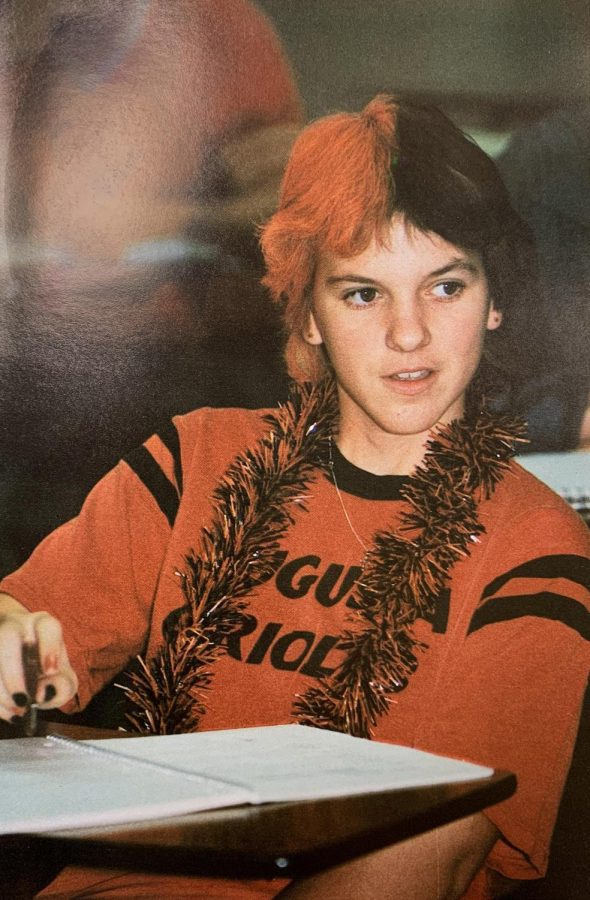 Polly++Wheat+wears+an+Orange+and+Black+themed+outfit+for+spirit+week.+She+was+a+student+who+attended+AHS+in+1985.+