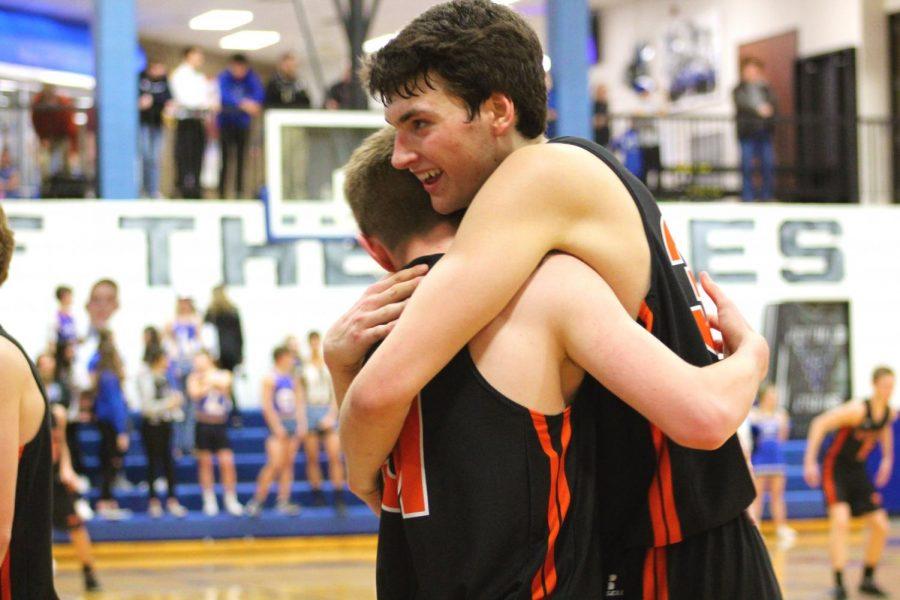 Seniors Zach Davidson and Garret Belknap hug after Belknap played for the first time since 7th grade. Davidson and Belknap have been friends for years.