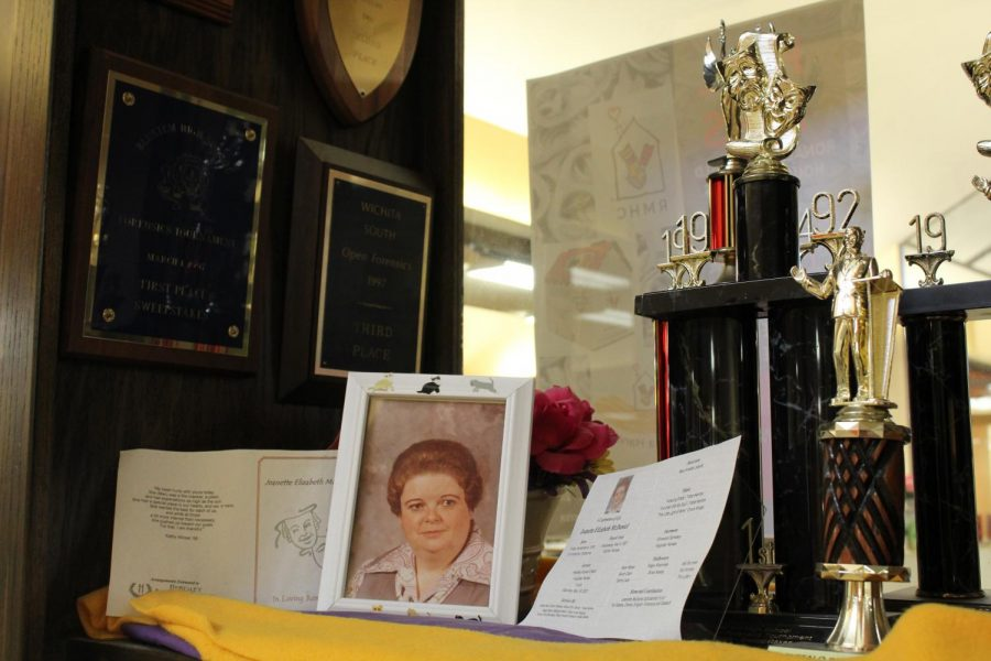 Two trophy cases in front of the library are dedicated to Jeanette McDaniel. They are filled with plagues and trophies she and her teams have won over the span of 31 years.
