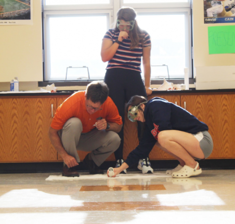 Sophomores Kallie Smith and Reese Ratcliff build a rocket while science teacher JD Hand assists their experiment. This form of learning would be considered tactile, due to the hands-on experience these students are facing.